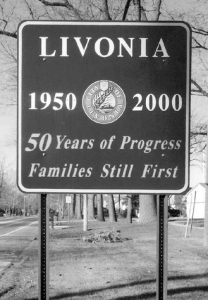 Livonia sign with city motto