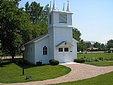 The Little Village Chapel was moved to it's current location in the Park in 2001.