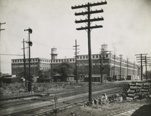 Sligh Furniture Co. in Grand Rapids, with nearby railroad in foreground.